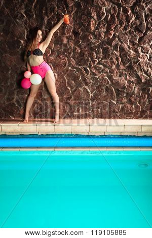 Woman With Coctail And Balloons On Pool.