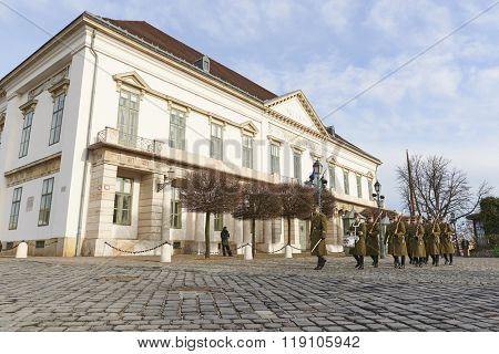 BUDAPEST, HUNGARY - FEBRUARY 02: Low angle host of Hungarian army marching in front of Sandor Palace. February 02, 2016 in Budapest.