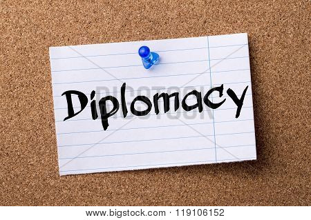 Diplomacy - Teared Note Paper Pinned On Bulletin Board