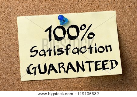 100% Satisfaction Guaranteed - Adhesive Label Pinned On Bulletin Board