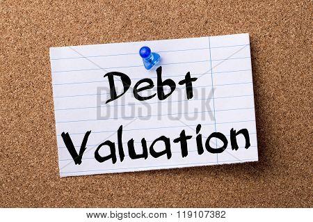 Debt Valuation - Teared Note Paper Pinned On Bulletin Board