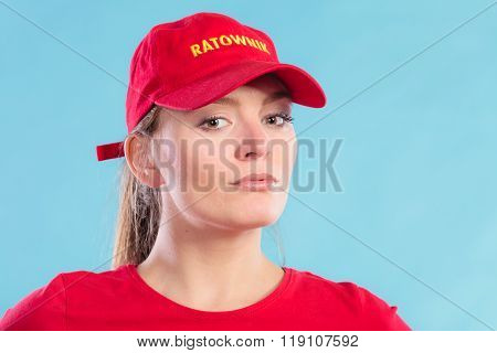 Portrait Of Lifeguard Woman In Red Cap.