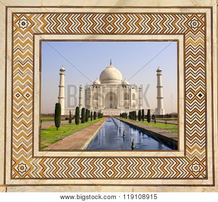Famous Taj Mahal mausoleum in frame of ancient mosaic on marble, Agra, India
