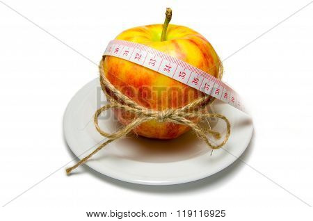 Apple Surrounding Of Measuring Tape Tied With Twine