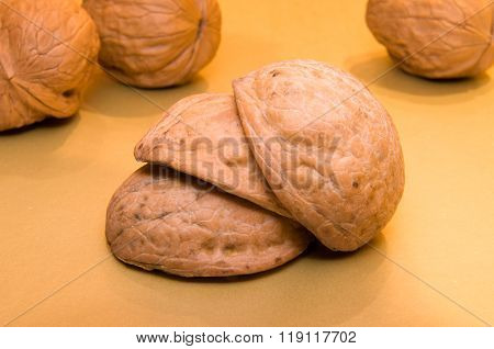 Walnuts Shell On Each Other On The Background Of Walnuts