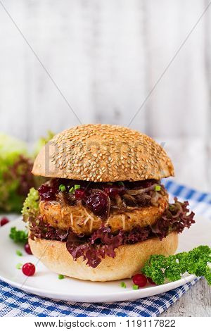 Hamburger With Juicy Turkey Burger With Cheese, Caramelized Onions And Cranberry Sauce