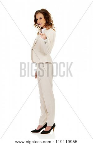 Businesswoman pointing on camera.