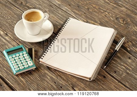Open Notepad With Pen, Coffee, Calculator With Gold Credit Card
