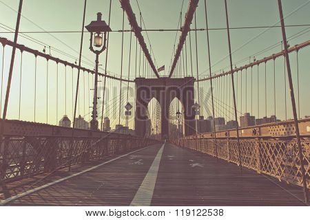 Retro Washed Out Color View of Historic Brooklyn Bridge with Arches and Cable Supports, Deserted Pedestrian Path with Old Fashioned Lamp in Warm Late Day Sun, New York City, New York, USA
