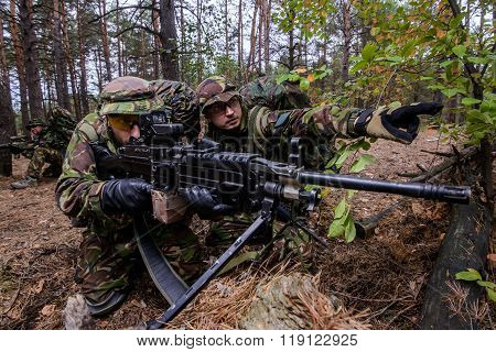 Soldier Demonstrates Target To Gunner In Forest