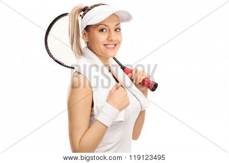 Studio shot of a young female tennis payer holding a racket isolated on white background