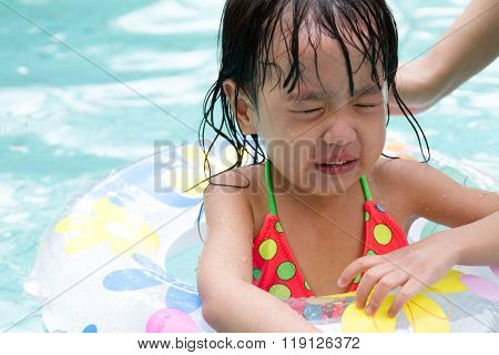 Asian Little Chinese Girl Playing In Swimming Pool