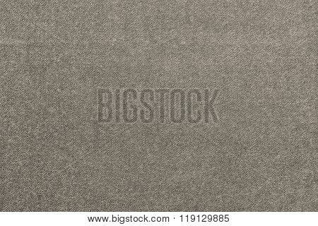 Speckled Textured Monochrome Background From Fabric Of Pale Beige Color