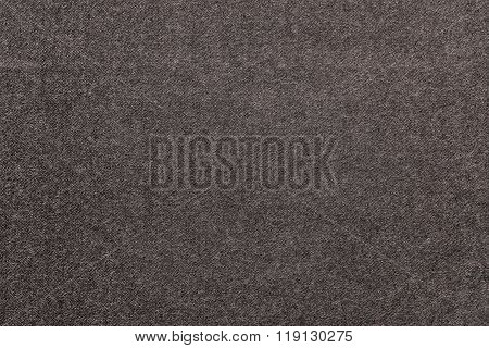 Speckled Textured Monochrome Background From Fabric Of Dark Beige Color
