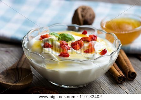 Bowl Of Greek Yogurt With Honey And Strawberry
