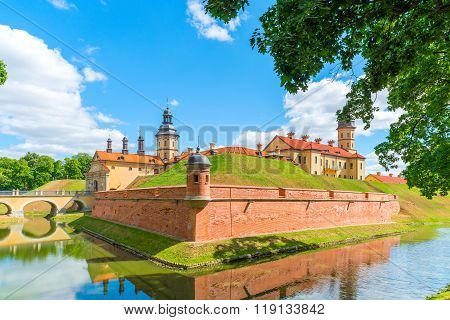 NESVIZH, BELARUS - August 18, 2015: Castle On The Hill And A Moat Around It