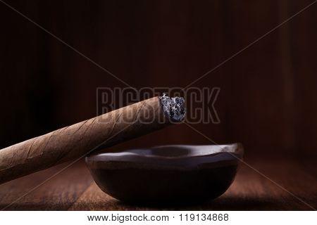 Cuban cigar in ash tray