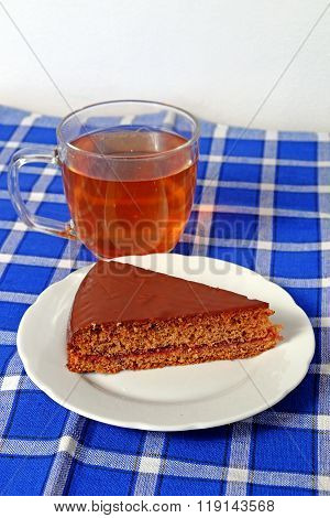 Homemade Gingerbread Topped With Chocolate On A White Plate With Tea