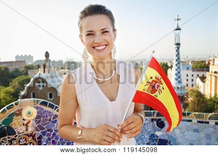 Woman Tourist With Spain Flag In Park Guell, Barcelona, Spain