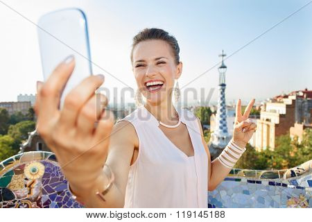 Woman Showing Victory And Taking Selfie With Mobile, Park Guell