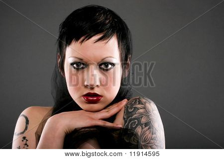 Beautiful young woman with gothic style short hair and makeup