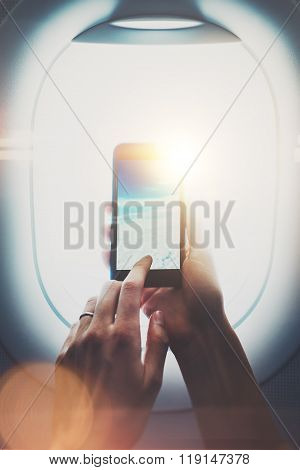 Photo of female hands making foto Of clouds on smartphone. Visual effects, blurred. Vertical, mockup