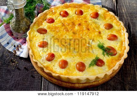 Open Pie Quiche Lauren With A Chicken On A Wooden Table In Rustic Style