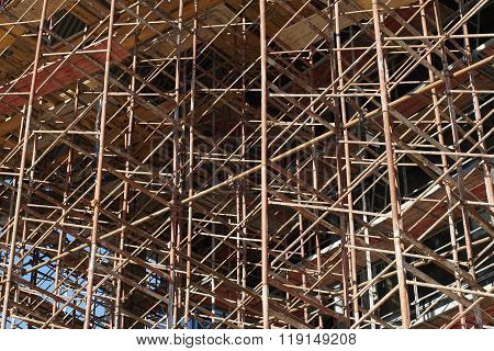 Unfinished Building. Scaffolding At Construction Site