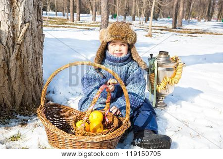 Little Boy In A Cap With Earflaps Plays Winter Park.  Russian Style.