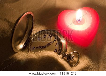 Watch and a candle