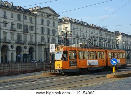TURIN, ITALY - JANUARY 11, 2013: Tram works on line 15 in Turin. Such trams are intended for movement on narrow streets of historical part of city