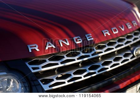 ST. PETERSBURG, RUSSIA - AUGUST 3, 2015: Red hood of the Range Rover car in a parking lot closeup. About 11'600 Land Rover cars was sold in Russia in 2015, it is 45% lower than a year earlier