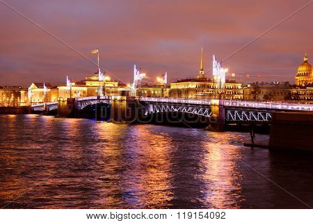 ST. PETERSBURG, RUSSIA - DECEMBER 19, 2015: Night view to illuminated Palace bridge across river Neva. Built in 1911-1916, the bridge is now one of the symbols of the city