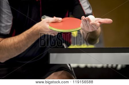 table tennis player serving - focus at the ball / small depth of focus