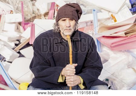 Homeless Sitting In Landfills In The Garbage