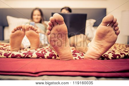 Couple In Bed And Technology