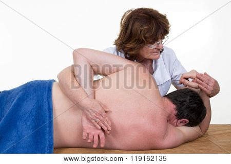 Experienced Physiotherapist Doing Woman's Spinal Column Manipulation