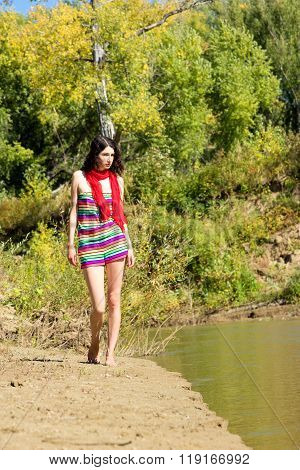 Young Beautiful Woman Walking Outdoor In Sunny Day