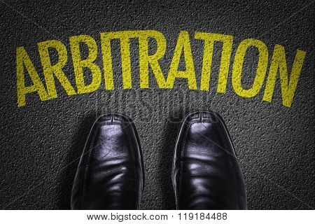 Top View of Business Shoes on the floor with the text: Arbitration