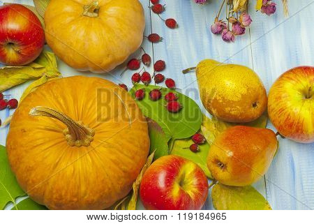 Pumpkin, Apples And Pears On A Blue Wooden Background