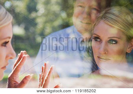Man and woman looking at reflections