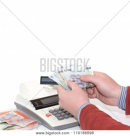 Man counting receipts and cash register on light background Romanian Lei Banknotes. Soft cool color.