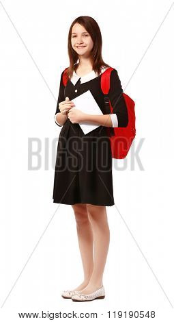 Beautiful schoolgirl with schoolbag and book isolated on white