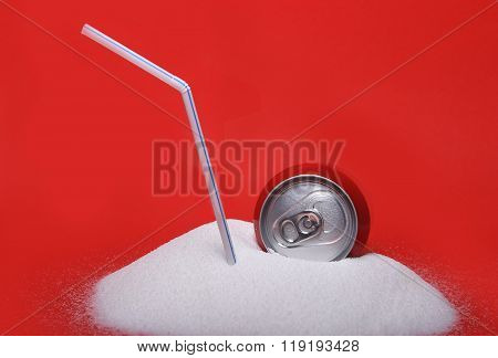 Straw And Cola Refreshing Drink Can Sitting In Pure White Sugar Mountain