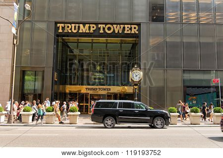NEW YORK - CIRCA SEPTEMBER 2015: Vehicle Parked in front of Entrance to Trump Tower with Gold Lettered Sign and People Walking Past on Sunny Day in Manhattan, New York City, New York, USA