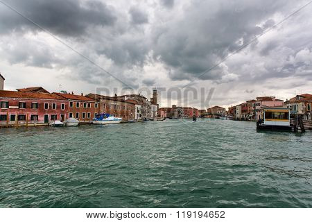VENICE, ITALY - 17 OCTOBER 2015: Approaching the vaporetto stop for public water buses on Murano Island, Venice, Italy known for its famous glassware