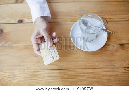Hand With Credit Card To Pay In Cafe