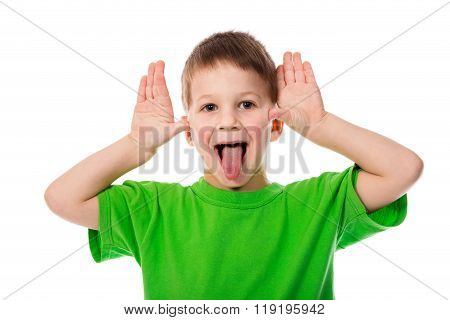 Funny little boy teasing with hands and tongue