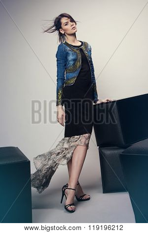 Woman in denim jacket and long dress