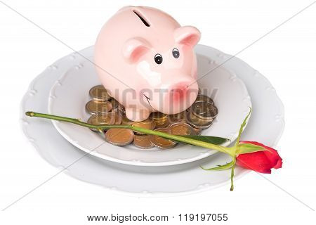 Piggy Bank With Coins On A Plate